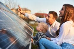 Family observing solar panels
